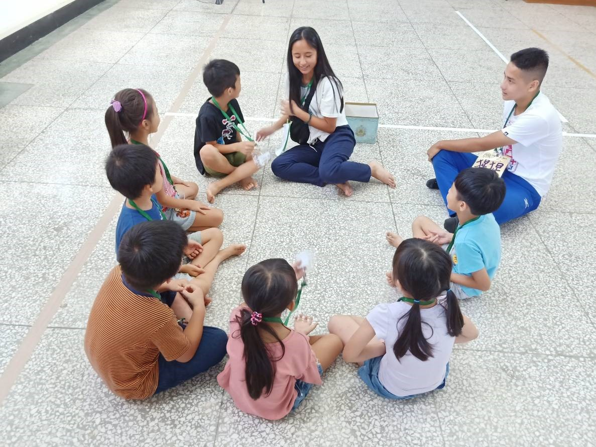 Lily sharing with children in the summer camp.
