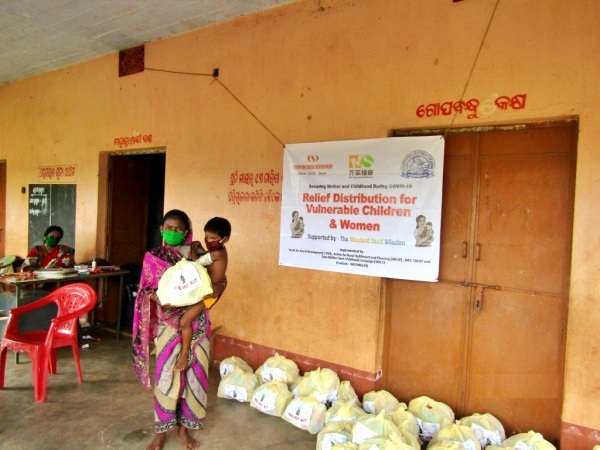 Women, girls and children in rural areas of India receiving relief supplies